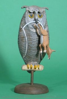 Screech Owl Decoy with Mouse carved by Jay Miles.  Please follow Kicking Bull Gallery on Facebook for latest carvings and updates.