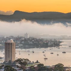 A foggy dawn greets a winter day in Hobart. Looking over Wrest Point toward Battery Point with the city and upper harbour shrouded in mist. The fog is known as the Bridgewater Gerry (yes, it has a name), and in cooler months it rolls downriver from the north, snaking along the mountain side of the   edge of the river. Image Credit: Tim, @Lake_of_Tranqulity