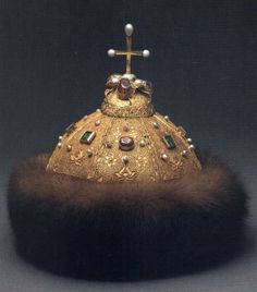 The Crown of Monomakh is the most ancient crown in the Russian Armory regalia collection.  The crown is dated by the13th-4th centuries. It consists of eight golden plaques, adorned with filigree, pearls and bright gems. Up till now there is no common idea of where it had been executed. The shape of the crown and motifs of the filigree ornament give evidence of Oriental origin.  Made of  gold, precious stones, fur, silk; casting, filigree, seeds of gold.