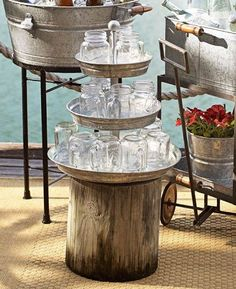 Galvanized Metal 3-Tiered Stand from Pottery Barn.  Use it to serve drinks in mason jars with striped straws.