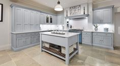 This stunning light blue kitchen features state of the art appliances. Both the cabinetry and beautiful island are painted in our very own Iris. Warm Grey Kitchen, Black And Grey Kitchen, Modern Shaker Kitchen, Grey Painted Kitchen, Shaker Style Kitchens, Light Blue Kitchens, Grey Kitchens, Home Kitchens, Kitchen Colors