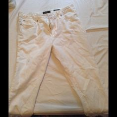 Jessica Simpson distressed skinny jeans White 98% cotton 2% spandex distressed jeans. Forever skinny, Low rise. Small stain on right thigh. Jessica Simpson Jeans Skinny