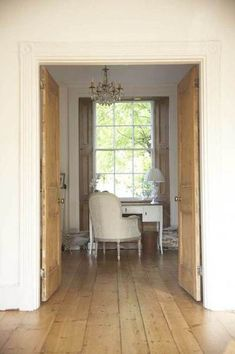 Vintage wooden double-doors/shutters & french antique chair & desk...splendid space!!...sam penner