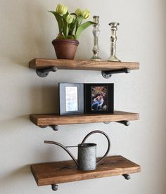 This is a combination of three shelves built with upcycled iron piping that will add a touch of class to a loft, office, rustic style home