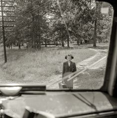 """BUY PRINT September """"Greyhound bus trip from Louisville, Kentucky, to Memphis, Tennessee, and the terminals. Girl waiting for bus by road's edge."""" Medium format negative by Esther Bubley for the Office of War Information. Photography Sites, Vintage Photography, Amazing Photography, First Bus, Bus Travel, Political Events, Back Road, High Resolution Photos, Photo Archive"""