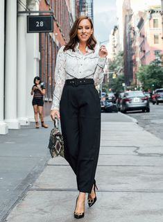24be4589393 Sydne Style shows office outfit ideas in white button shirts  western  fall   officeoutfits