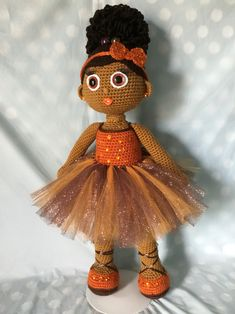 Crochet Doll; Adobe  African American girl with curly Afro puff, removable brown and orange tulle tutu and sparkly orange rhinestone studded hair bow headband.