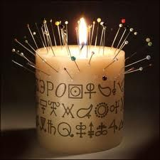 Hoodoo Magick Rootwork:  Hoodoo candle.  I know I am evil and what not, but everyone could use one of these!
