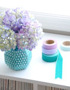 Purple-hued flowers in a turquoise, thrift store vase. From @ez pudewa. housebeautiful.com #colorful_ribbon #flower #design_inspiration