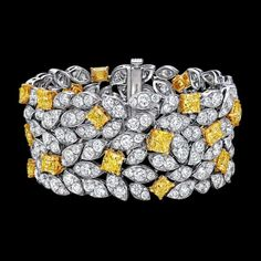 Graff Diamond Leaf Motif Bracelet Delicate pavé diamond leaves are interspersed 26 radiant cut yellow diamonds. Each diamond is meticulously positioned by Graff's Master Craftsmen resulting in a truly eye-catching jewellery piece. Graff Jewelry, Luxury Jewelry, Modern Jewelry, Fine Jewelry, Diamond Bracelets, Gemstone Bracelets, Diamond Jewelry, Bangle Bracelets, Sapphire Bracelet