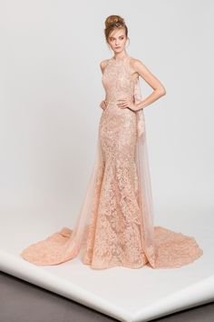 Powder pink evening dress in embroidered tulle with a cape, embedded on the sides with crystals and sequins.