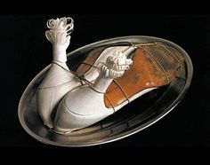 Meret Oppenheim: another brilliant Surrealist transformation of every-day objects into strange subversive ideas!