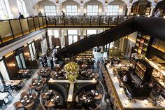 An elegant restaurant and bar in the beautifully restored German Gymnasium at…