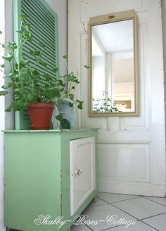 Our rear entrance with an old shabby chic door... I love this little dresser (for the shoes of my little boys)