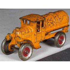 Kenton Cast Iron Tanker Toy Truck, orange. Overall good condition. 6 inches long.