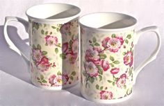 Fine English Bone China Mugs - Wild Rose Chintz - Set of Two Fine English Bone China. Made in England by Heraldic Pottery, Staffordshire, England. Open Wild Rose Chintz on a very pale yellow background. Dishwasher and Microwave Safe. Gift Wrapping Available at Checkout.  #Heraldic_Pottery,_England #Kitchen