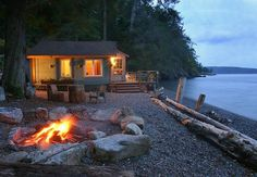 """I wanna go! ~ Boathouse rental cabin on Orcas Island, Washington State. If you don't own a cabin or """"water"""" vacation home - this is the place to go in the San Juan Islands of Washington State, where you can """"island hop"""" via Island Ferries. Tiny Beach House, House Near Beach, Orcas Island, Water House, Houses On The Water, Little Cabin, House By The Sea, House On Land, Cabins And Cottages"""