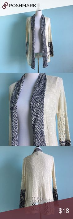 Cream & Navy Cardigan Comfortable cream-colored Cardigan with navy accents on sleeves and collar. Wider circle knit on elbows and lower hem. Great to throw on over anything. Size large. New without tags, never worn. Sweaters Cardigans