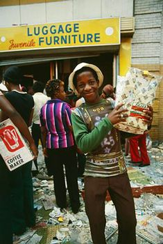 Blackout of 1977-Showing Off Spoils    A young looter holds up a pair of pajamas he took from a store in the Bushwick section of Brooklyn after massive power failure in New York.    Photo: Bettmann / Corbis