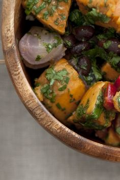 NYT Cooking: Start with sweet potatoes, which are in season, beautiful and cheap, and roast them with red onion and olive oil. Roasting instead of boiling makes a huge difference: not only do you get a rich, smoky flavor, but the peeled exterior is toughened a bit so that the potatoes stay intact when tossed with the other ingredients. You can serve this sweet potato salad warm%2...
