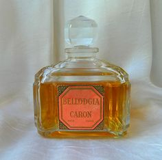 BELLODGIA Pure Perfume (Extrait) ....Parfums Caron  Created in 1926 by Ernest Daltroff . The crystal falcon container was introduced in 1946 by Cristalleries de Baccarat.