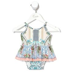 Beach Shack Baby Tutu Onesie Vibrant bohemian kids clothes by Camilla. The Beach Shack Babies Tutu Onesie draws inspiration from calming coastal beach walks, featuring a contrast peplum skirt, adjustable straps and convenient snap stud closure. - Self fabric bind on neck, arm hole and leg line - Snap stud opening - Adjustable straps - Contrast fabric frill skirt Colour: Beach Shack Print. Fabric and care: 94% Cotton, 6% Elastane. Size and fit: True to size. #tinypeopleshop #kidsfashion… Bohemian Kids, Baby Boutique Clothing, Frill Skirts, Cool Kids Clothes, Beach Shack, Baby Tutu, People Shopping, Kids Branding, Camilla