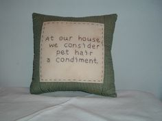 "This 8"" square calico pillow is hand-embroidered with a funny message that is sad but true."