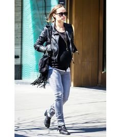 @Who What Wear - Olivia Wilde                 Gucci Nouveau Fringe Suede Shoulder Bag ($2500)? Check! Leather jacket? Check! Black boots? Check! Wilde's inner rocker has officially surfaced!