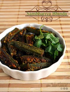 Gujurati Sambhariya Bhindi Recipe - okra stuffed with coconut, peanuts, sesame seeds, and cilantro. Indian spices of course. Okra Recipes, Curry Recipes, Vegetarian Recipes, Cooking Recipes, Recipies, Healthy Recipes, Gujarati Cuisine, Gujarati Recipes, Indian Food Recipes