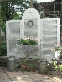 Privacy fence from shutters~ cute idea to replace that lattice thing.