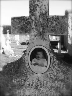 Baby cameo on a headstone from the 1920s