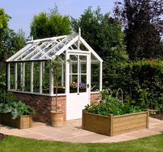 White Cottage Greenhouse- my father-in-law is going to build one for me! I really like this one and it's a good size for our backyard. He can build anything and loves to garden, too!  How did I get so lucky?? I'm so excited to learn from him!