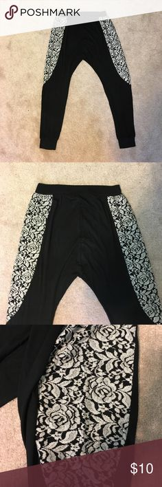 Black and White Lace Harem Pants Black and white lace harem pants from Just for Kix.  Cuff at ankles.  Lace design on both sides.  Material is light and extremely comfortable.  95% rayon and 5% spandex.  Never worn.  Waistband is approx 13 in wide (will stretch to approx 20 in).  Length is approx 35 in long.  Size small. Pants Track Pants & Joggers