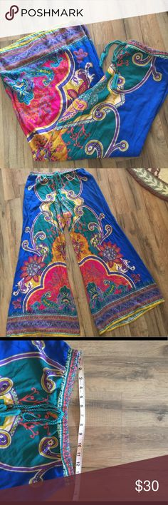"Boho palazzo pants These gorgeous boho colorful pants are exactly what you need this summer! Size large but fit like a medium. Elastic waist measures 14"" inseam 29"" rise 12"" Flying Tomato Pants Wide Leg"