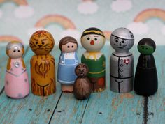 Wizard of Oz peg doll set - 7 pegs a cross between the lion and Toto would look like a wookie.