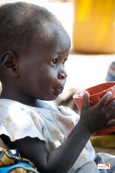 "In Zambia, 18-month-old Cossy's mother Josna shares, ""I don't remember when my family last ate two meals in a day. This whole year has been tough for my family after failing to harvest anything from last farming season."" Here, Cossy drinks a traditional porridge to give him energy. (Photo: 2013 Collins Kaumba/World Vision)"