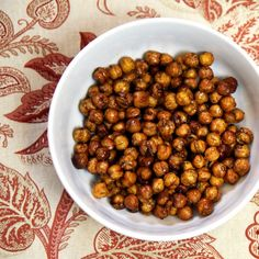 Ingredients:    15-ounce can organic garbanzo beans  1/2 tablespoon olive oil  1 tablespoon honey  1/2 teaspoon cinnamon  1/8 teaspoon nutmeg  1/8 teaspoon sea salt    Directions:    Preheat oven to 375 °F. Line a baking sheet with parchment paper