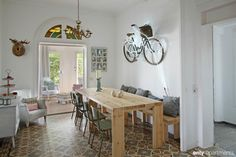 GREEN HOUSE Apartment, Barcelona, Spain. We love the bike on the wall !