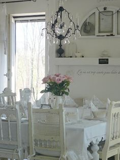 group mismatched chairs in varying shades of whites and creams around the dining room table