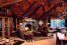 I like the idea of the fire place being in one corner of the room as a focal point. That way, the TV could be in another corner, like 2 sections in the same room.