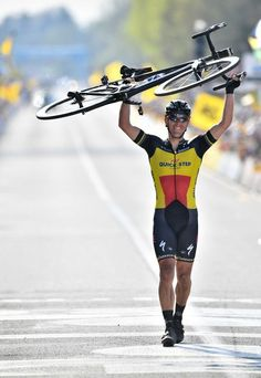 Belgian cyclist Philippe Gilbert of QuickStep Floors raises his bike as he crosses the finish line and win the edition of the Ronde van. Cycling Wear, Pro Cycling, Cycling Bikes, Run And Ride, Grand Tour, Road Bikes, Touring, Racing, Instagram