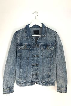 Relaxed fit denim jacket in an edgy vintage wash. Comfortable to wear and not heavy. It has front button closure and two chest pockets. 100% Cotton Bust: 38 inches / Waist: 36 inches / Length: 22 inch