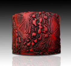 wow, just gorgeous!  http://www.etsy.com/listing/76700783/bold-red-and-black-polymer-clay-cuff?ref=af_circ_favitem