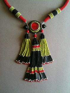 Red Black Green Tassel Necklace front detail.  Seed bead woven, bead embroidery by Jeka Lambert.  Glass beads, seed beads, bugle beads.