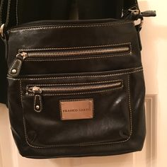 Cross Body Purse New and never used . Beautiful classic design leather with silver embellishment. This great bag has five compartments!  Franco Sarto Bags Crossbody Bags