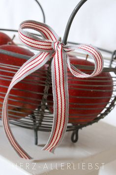 I'd like to add ribbons like this to my little metal basket ♥
