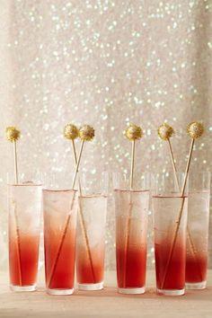 Pom-pom drink stirrers. So cute to jazz up a holiday party bar.