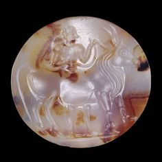 Agate seal with a man leading a bull  Minoan, about 1500-1300 BC  From Crete    Minoan craftsmen were particularly skilled at the art of seal engraving. Though small, Minoan seal stones often show scenes that are both beautifully carved and an insight into this ancient culture.