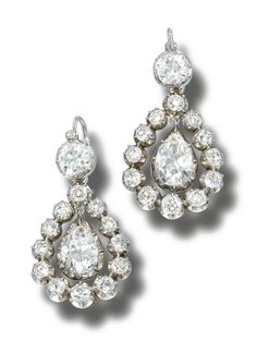 PAIR OF DIAMOND PENDENT EARRINGS, CIRCA 1900.  Each surmount set with a cushion-shaped diamond in cut-down collets, supporting a removable pear-shaped diamond swing centre bordered by a removable frame of cushion-shaped diamonds,  case.    latter fittings,