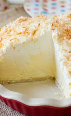 Coconut Cream Pie ~ Outrageously addictive, just in time for summer parties... Fluffy, creamy, and oh-so coconutty.